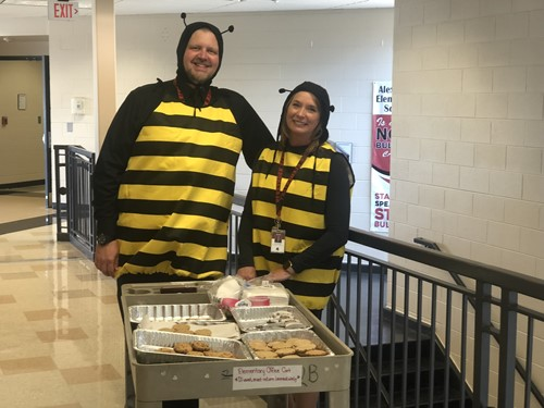School Principals dress as bees to celebrate School Report Card