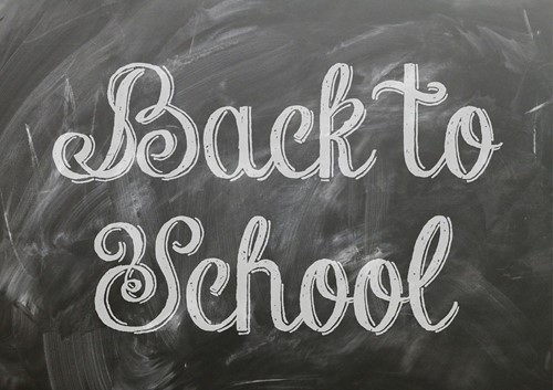 png with back to school written on a chalkboard